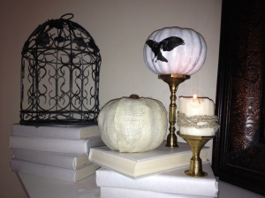 I painted an old bird-cage, and decoupage 3 dollar store pumpkins--one with the poem, one with burlap, and one with a raven (that will be replaced when I can get a large white pumpkin). The books are wrapped in white paper and the candle is wrapped with braided twine.